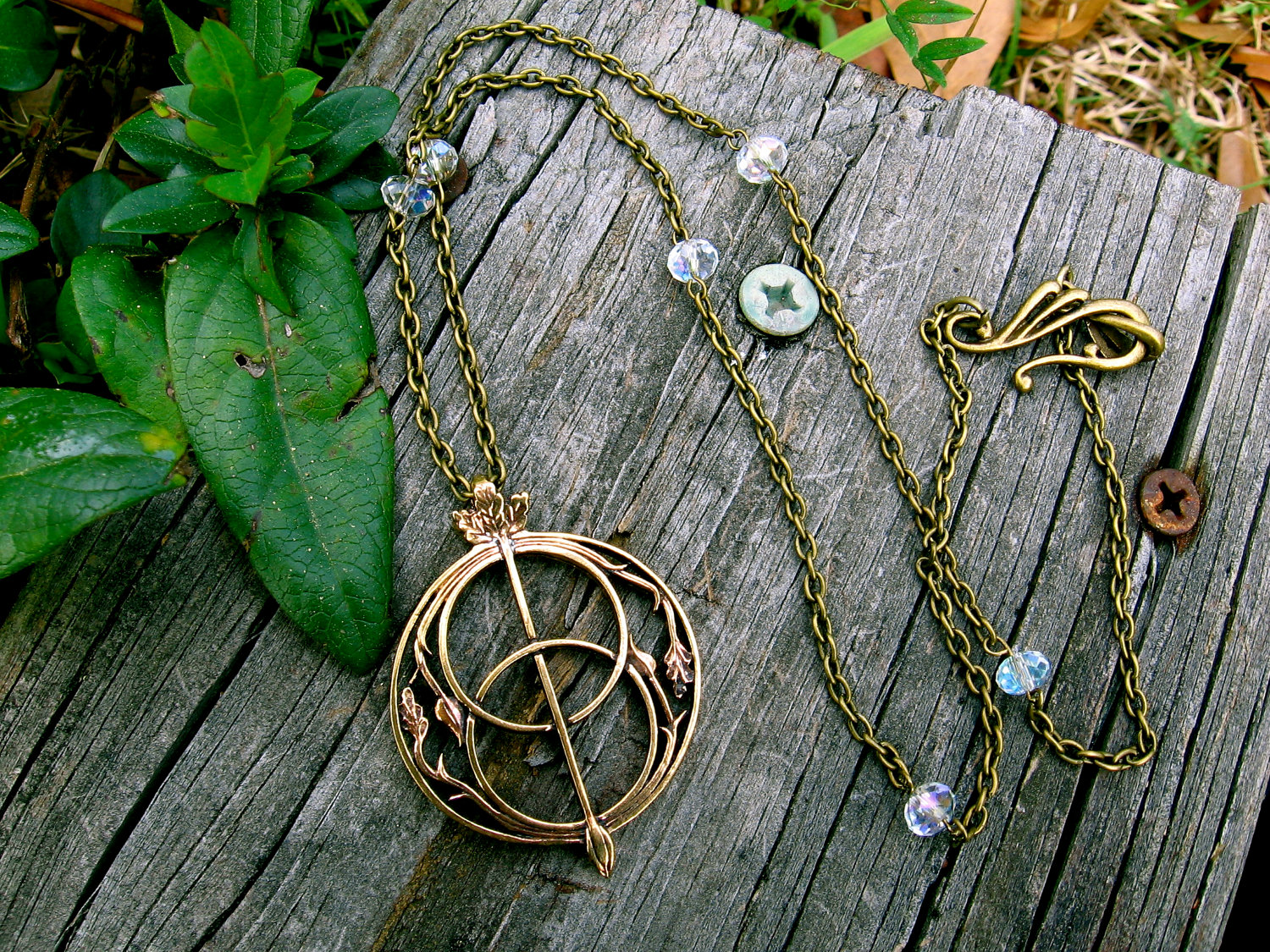 Chalice Well Necklace by EireCrescent on Etsy.