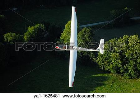 Stock Photography of A trainer glider Grob Twin Astir fliying over.