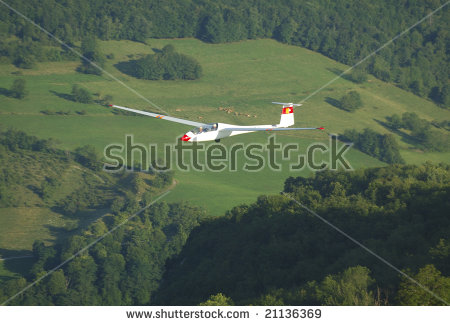 A Glider Janus A Flying Over Alps Mountains At Challes Les Eaux.