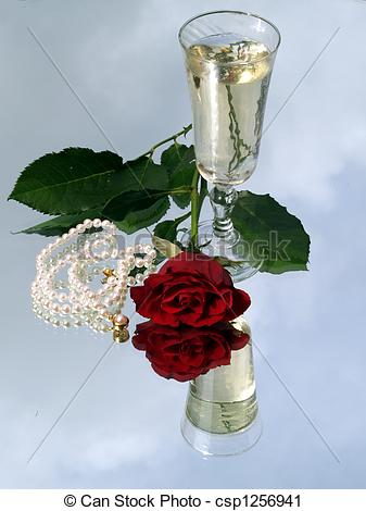 Stock Photography of Champagne, rose and pearls.