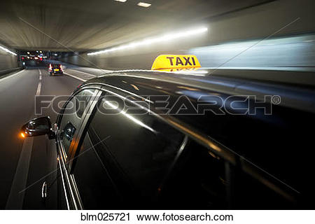 Stock Photography of A taxi cab changing lanes in a tunnel.