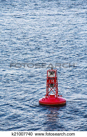 Stock Photography of Red Channel Marker on Blue Waves k21007740.