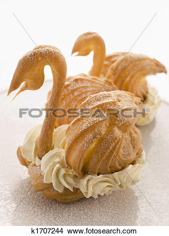 Stock Photo of Two Choux Swans filled with Chantilly Cream.