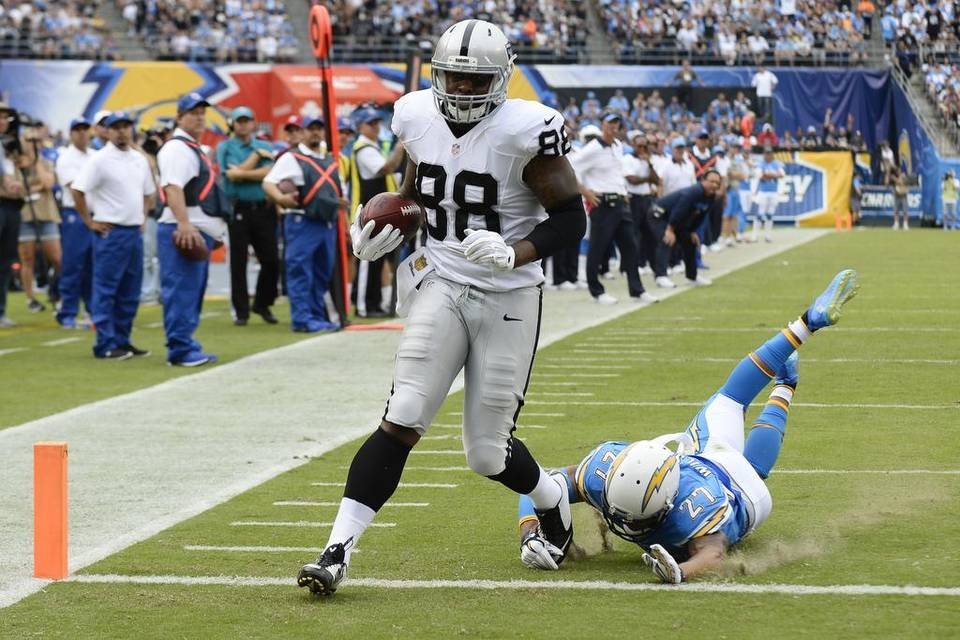 Gallery: Raiders score big early, hang on to beat division.