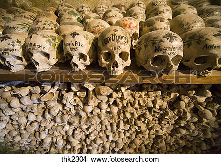 Stock Photo of Painted sculls in the Charnel House of Hallstatt.