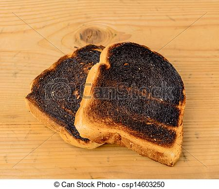 Stock Photography of burned toast bread slices.