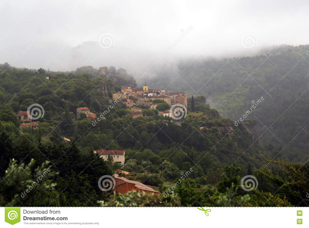 Chateaudouble Above The Mist Covered Forests Of The Var Stock.