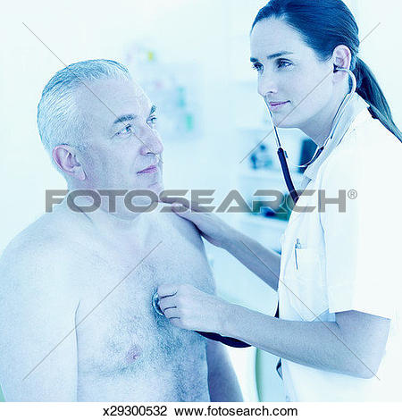 Stock Photo of nurse checking heart beat of elderly man with a.