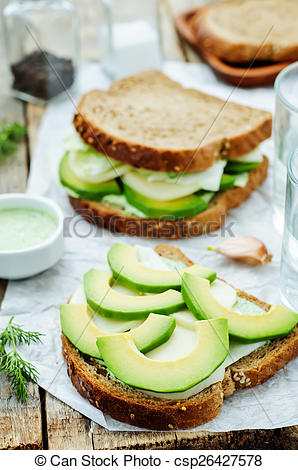 Picture of sandwiches with avocado, cheese, cabbage and cheese and.