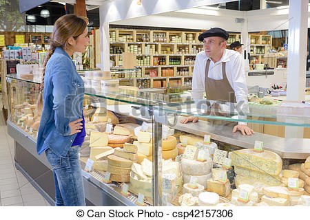 Stock Photography of Woman at French cheese counter csp42157306.
