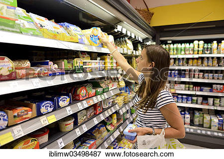 "Picture of ""Young woman shopping in a supermarket, at the cheese."