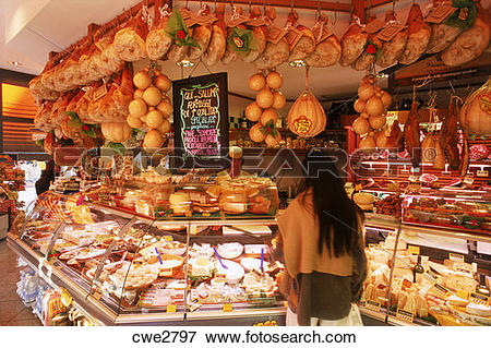 Picture of Woman in small meat and cheese market in Rimini Italy.