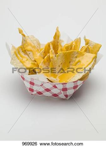 Stock Images of Nachos with cheese sauce in paper dish 969926.