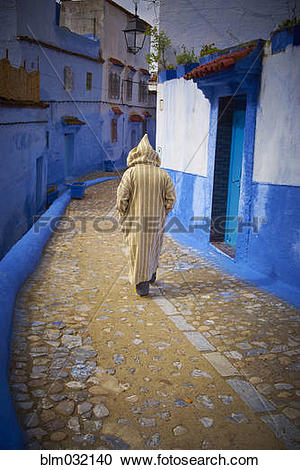 Stock Photography of Caucasian hooded man walking on colorful.