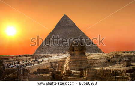 Sunset Over Sphinx And Pyramid Of Chefren In Giza Stock Photo.