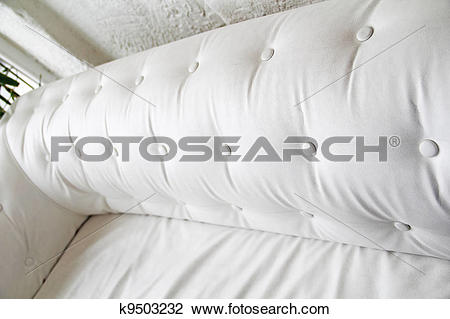 Clip Art of Back of white leather sofa. Textured button.
