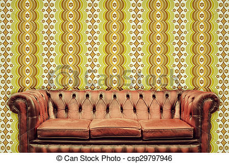 Stock Photo of Retro styled image of an old chesterfield sofa in.