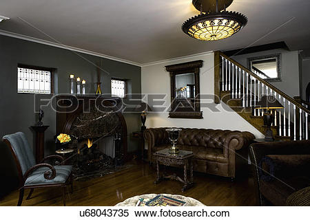 Stock Image of LIVING ROOMS: brown leather Chesterfield sofa, Art.
