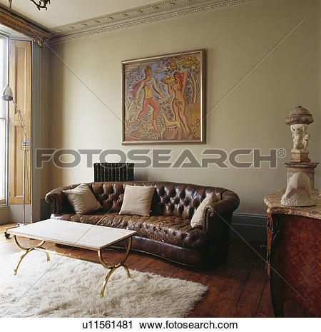 Stock Photography of Large picture above brown leather.