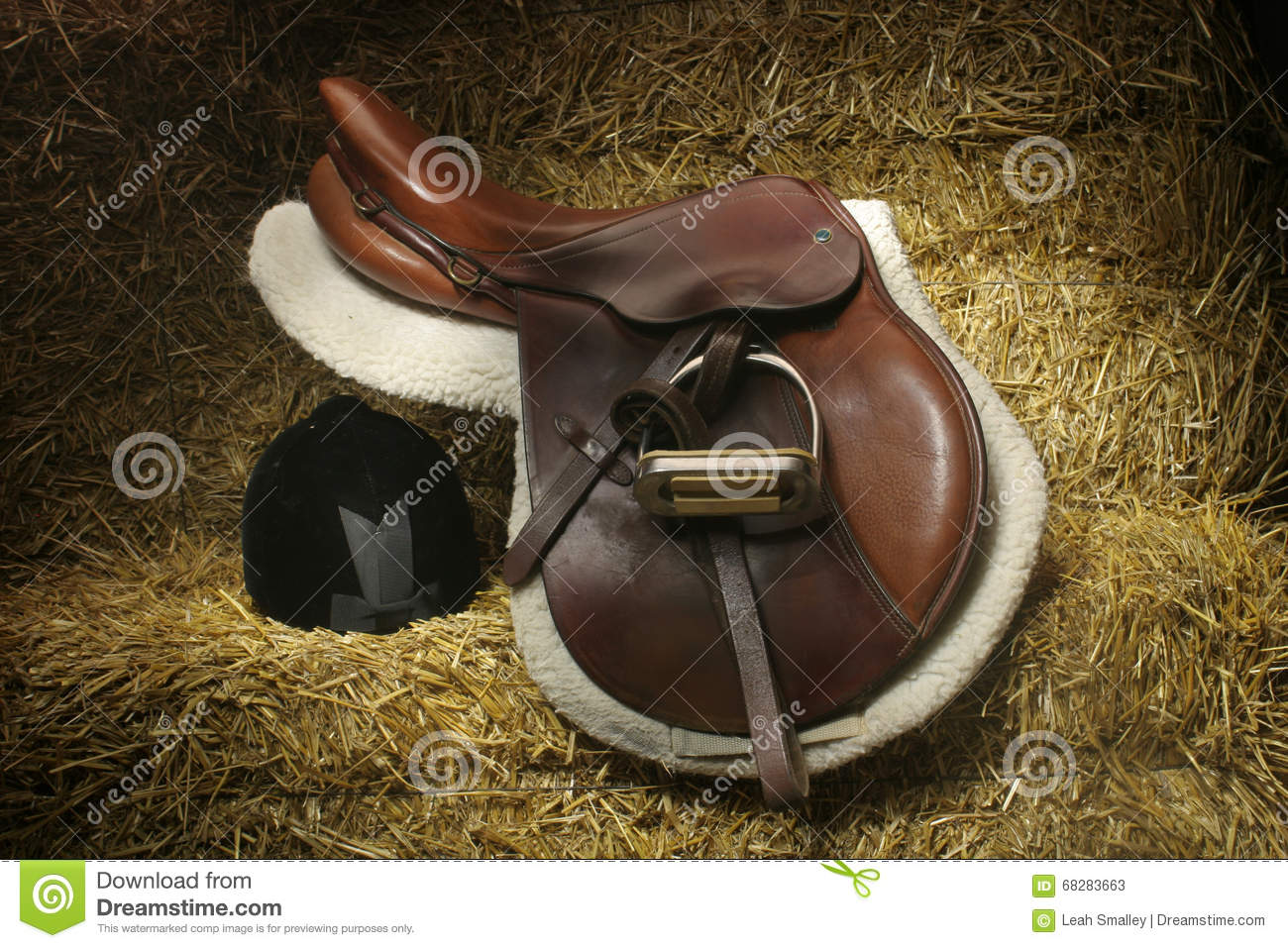 Hunter/jumper Saddle And Hunt Cap On Bales Of Straw Stock Photo.