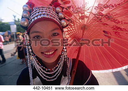 Stock Photography of Portrait of an Akha tribal woman holding a.