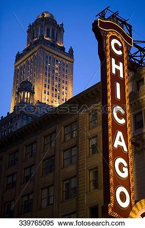 Stock Image of Low angle view of Chicago neon sign lit up at dusk.