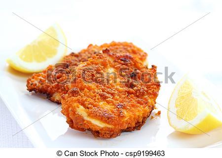 Stock Photos of Fried chicken schnitzel with lemon csp9199463.