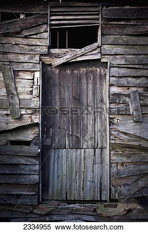 Stock Image of Ruined door of an old chicken coop; Surrey, England.