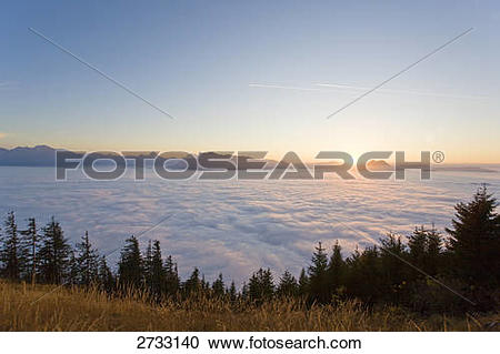 Stock Photography of Ocean of clouds with mountain range in.