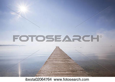 """Stock Photo of """"Very long jetty on Chiemsee Lake with high fog and."""