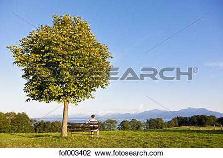 Stock Photo of Germany, Bavaria, Chiemgau Alps, Chiemsee, Men.