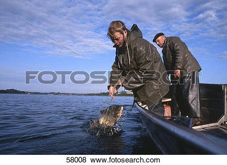 Pictures of Woman fishing in sea, Chiemsee, Munich, Bavaria.