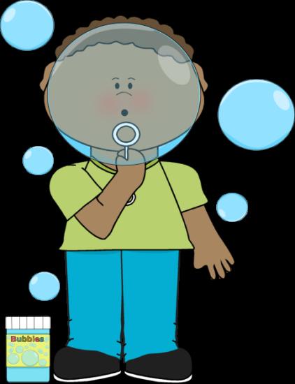 Boy blowing bubbles.