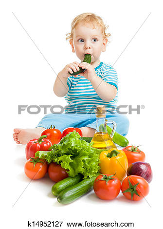 Picture of baby eating healthy food vegetables on white background.