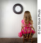 Little girl in time out or in trouble looking, with clock on.