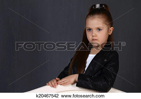 Stock Photo of beautiful young female child model wearing a black.