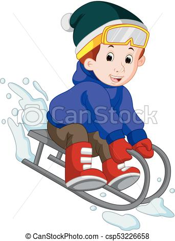 cute boy sledding in snow.