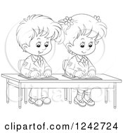 Clipart Blond School Boy Reading A Book At His Desk.