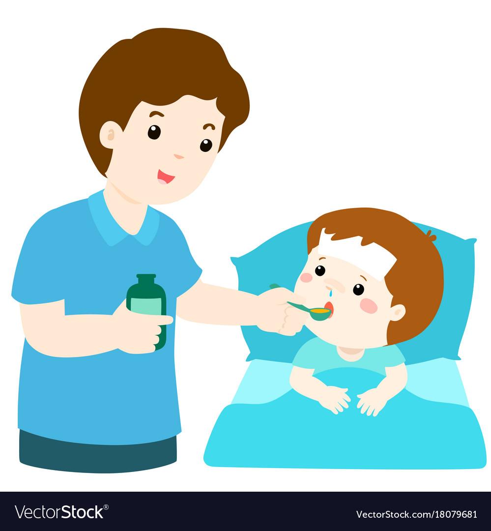 Father giving son medicine.
