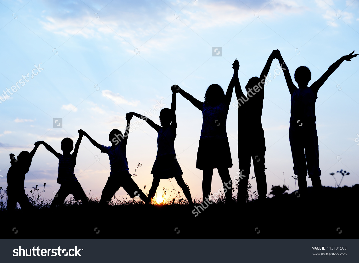 Children Silhouettes Holding Hands Stock Photo 115131508.