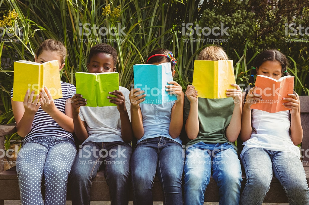 Children Reading Books At Park stock photo 474967010.