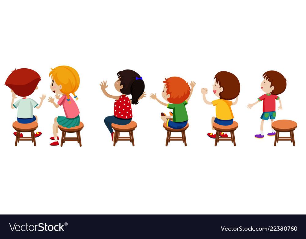 Children sitting on chairs.