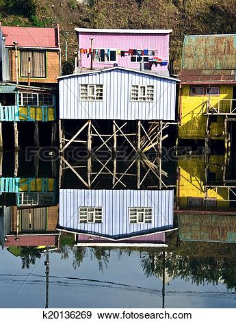 Stock Photograph of Palafito houses above the water in Castro.