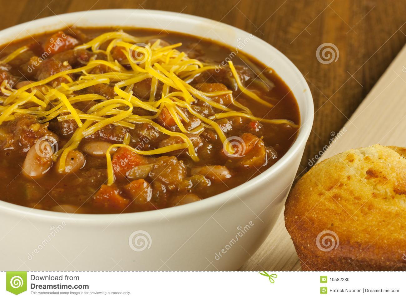 Bowl Of Chili With Cornbread Stock Photo.
