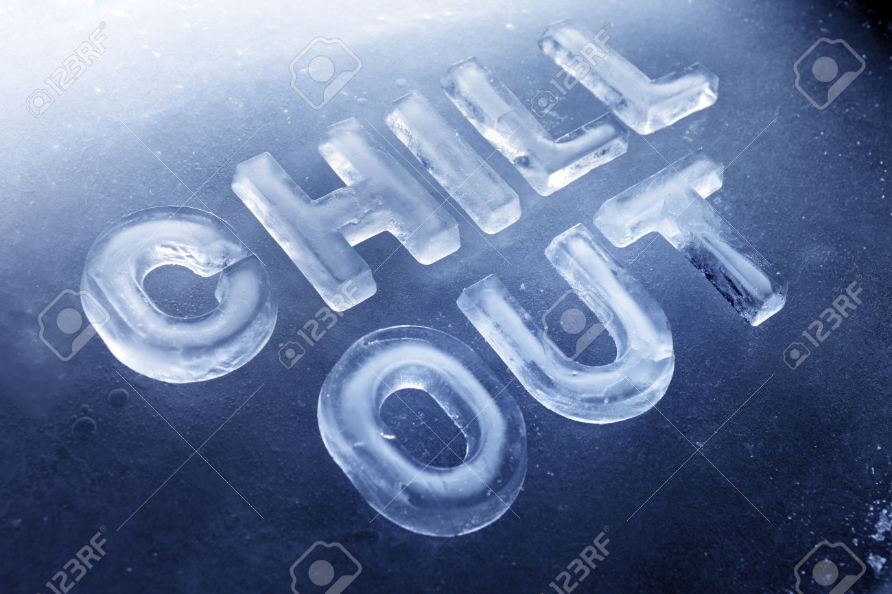 """Words """"Chill Out"""" Made Of Real Ice Letters On Ice Background."""