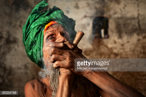 Sadhu Smoking A Chillum Stock Photo.