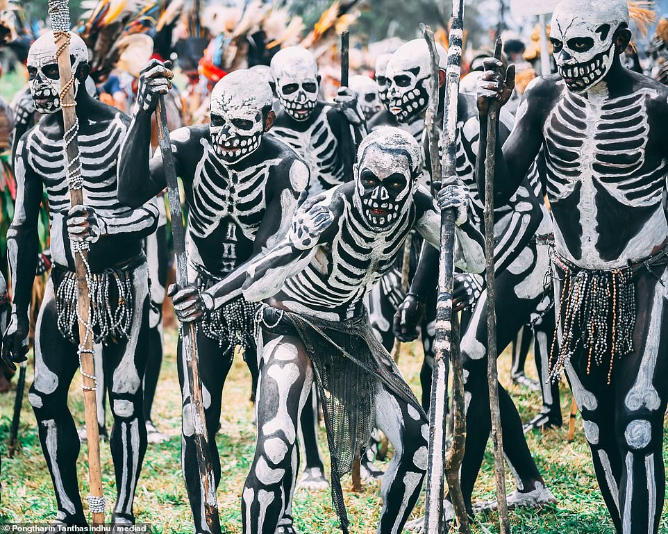 Papua New Guinea 'skeleton' tribe dress up as corpses to scare off.