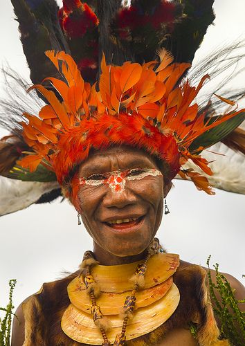 Chimbu Tribe Woman With Giant Headdress Made Of Eagle Feathers.