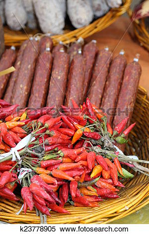 Stock Image of spicy Italian sausage and red peppers sold at.