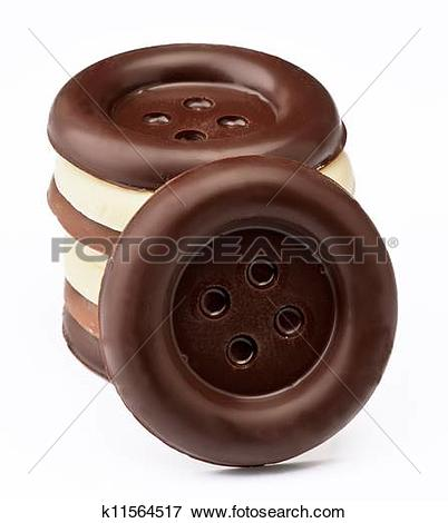 Picture of group stacked chocolate buttons, on white base.